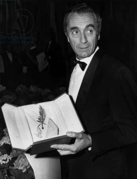 """Italian Director Michelangelo Antonioni (1912 - 2007) Receiving The Palme D'Or at Cannes Festival For """"Blow Up"""", 1967 (b/w photo)"""