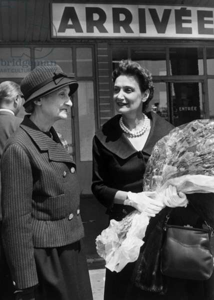 Lady Fleming (R, The Wife of Alexander Fleming) Was Greeted By Mrs Andre Maurois (L), The Wife of Andre Maurois (Academician) Who Had Published A Book About Alexander Fleming (Inventor of The Penicillin) in Paris, June 15, 1959 (b/w photo)