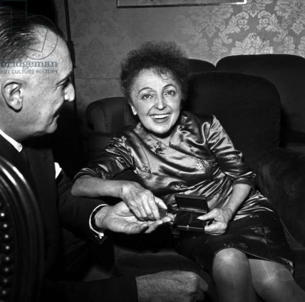 """French Singer Edith Piaf during The """"Marathon De La Chanson"""", She'S Going To Have A Medal, November 15, 1960 (b/w photo)"""