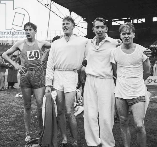 Meeting of athletism in Colombes, France, September 9, 1950 : here the athlets Marcel Hansenne (FR), John Parlett (GB), Roger Bannister (GB) and Michel Clare (FR) (b/w photo)