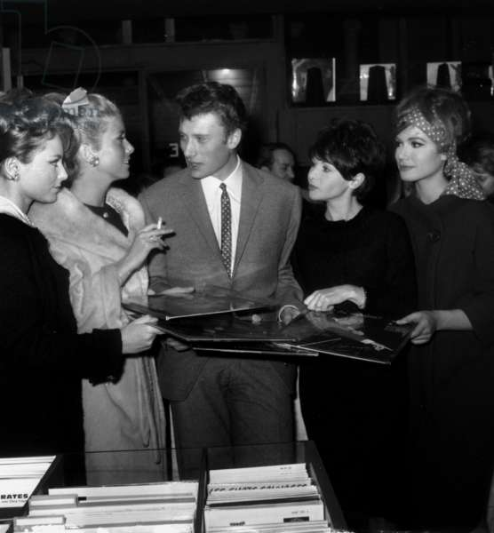 Johnny Hallyday Signing his Record To Gisele Sandre, Catherine Deneuve, Francoise Arnoul and Olga Georges Picot January 6, 1962 (b/w photo)