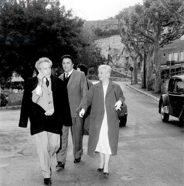 Federico Fellini and Giulietta Masina Going To The Chapel Decorated By Jean Cocteau May 13, 1957 in Villefranche-Sur-Mer (France) during Cannes Film Festival (b/w photo)