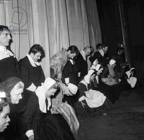 "French actors (among them Simone Signoret and Yves Montand) greeting after the lastrehearsal of play ""The Crucible"" at the Theatre Sarah-Bernhardt in Paris on December 14, 1954 (b/w photo)"