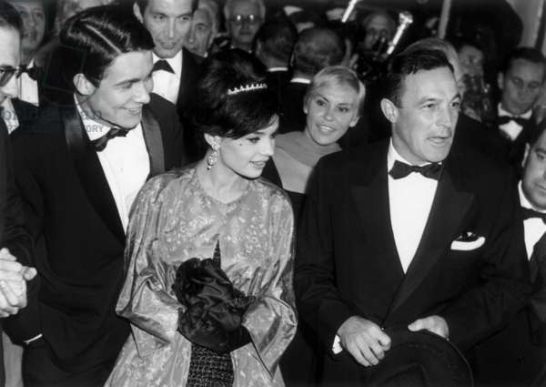 Jacques Charrier, Pascale Petit and Gene Kelly at Cannes Film Festival on May 2, 1959 (b/w photo)