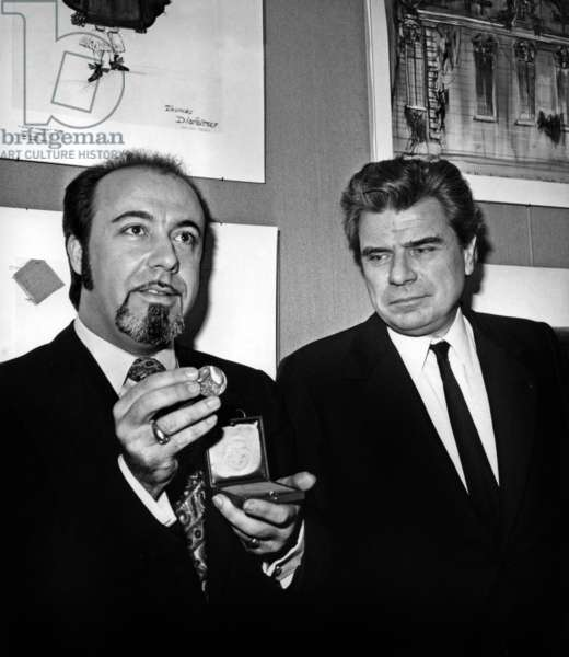 """Jean Laurent Cochet After Having received the Grand Prize for Best Director of Theatre (For His Direction Of La Comedie De Moliere """"Le Malad Imaginaire"""" At La Comedie Francaise) Here Felicite By Jacques Duhamel Minister of Cultural Affairs February 3, 1972 Chez Dominique Rue Brea A Paris (b/w photo)"""