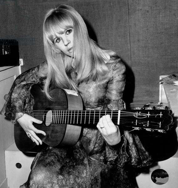 Singer Marianne Faithfull in Dressing Room at Olympia in Paris Singing With her Guitar March 25, 1966 (b/w photo)