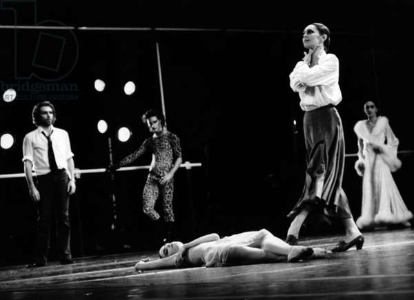 A Scene Of The Ballet 'Concours' With Schonach Mirk, Jorge Donn (The Inspector) And Grazia Galante (The Mother D'Ada) In A Scene Of The 'Concours' By Maurice Bejart On April 17, 1985 At the Theatre Musical de Paris. (b/w photo)