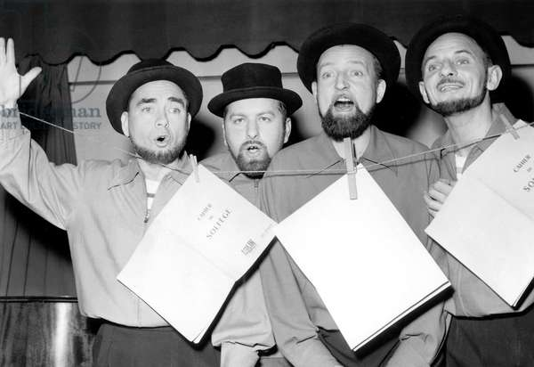 Les Quatre Barbus (The Four Bearded Men) French Singers Sing A Song About Jerome-Victor Obdebec, Inventor of The Clothes Peg, January 1954 (b/w photo)