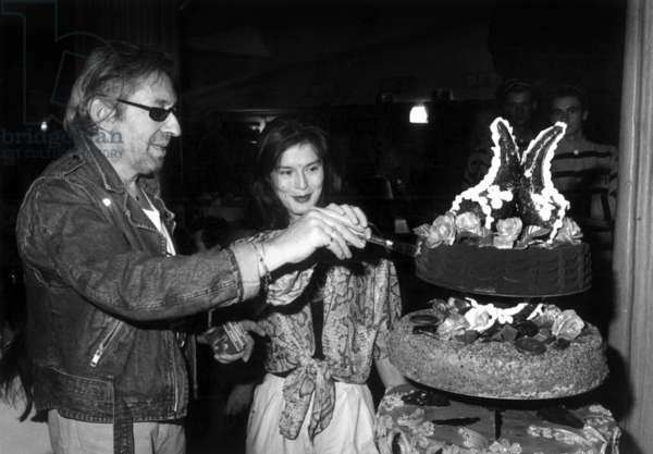 Serge Gainsbourg Celebrating his Birthday at The Palace in Paris With his Last Wife Bambou on March 22, 1988 (b/w photo)