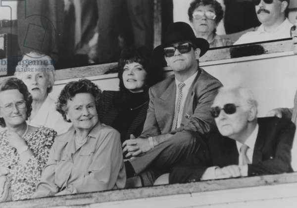 The Englis Singer Elton John and his Wife Renata Created Surprise When They Appeared Together during The Last Football Match of The Season in The Club of Watford, on May 12Th, 1987 (b/w photo)