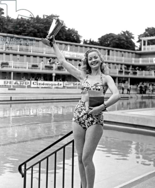 Contest of The Most Beautiful Bather and One of The 1St Public Appearance of Bikini on July 5, 1946 in Paris : here The Winner of The Contest With her Cup (b/w photo)