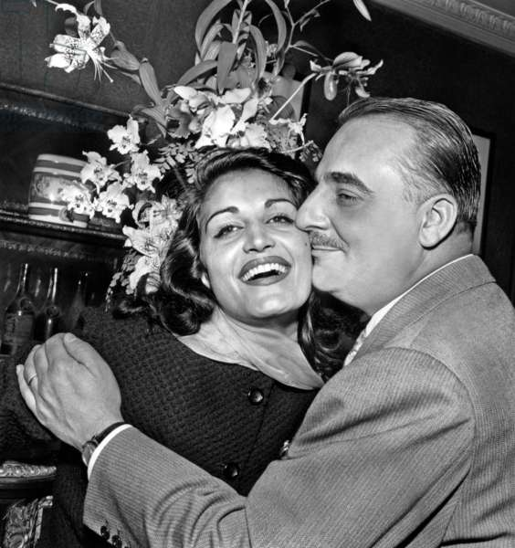 """Dalida and Bruno Coquatrix during A Cocktail in Paris on September 17, 1957 To Celebrate Success of her Song """"Bambino"""" (b/w photo)"""