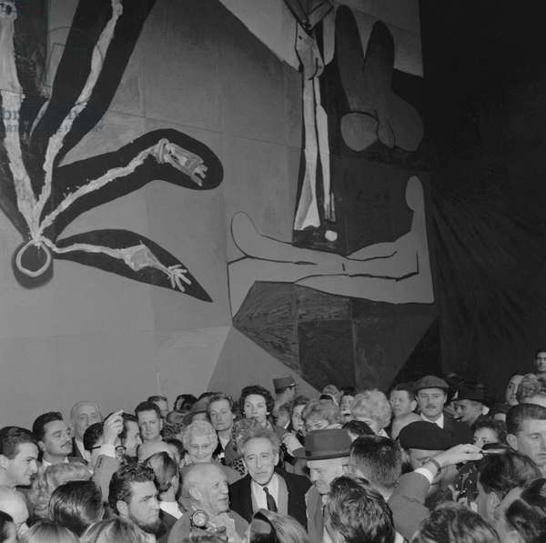 Spanish painter and sculptor Pablo Picasso presenting his 80 square meter 'Icare' mural destined to decorate the UNESCO building in Paris, here in Vallauris with French poet Jean Cocteau and leader of the French Communist Party Maurice Thorez, on March 30, 1958