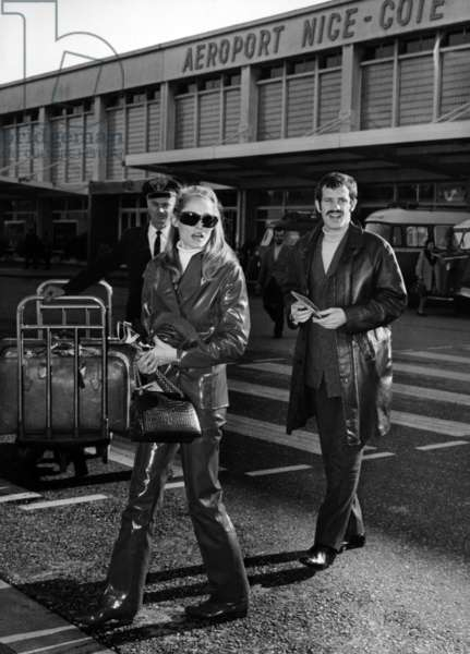French Actor Jean Paul Belmondo and Swiss Actress Ursula Andress Arriving at The Airport. Nice, France, November 25Th 1966. (b/w photo)