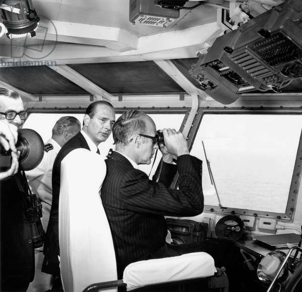 French President Valery Giscard D' Estaing and French Prime Minister Jacques Chirac Looking at Navy Parade in Nice (South of France) From Clemenceau Aircraft Carrier July 13, 1976 (b/w photo)
