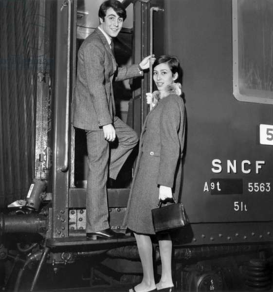 Marie Claude Abalain and Michel Delpech taking the train to Cannes for a debutante ball, December 16th 1965 (b/w photo)