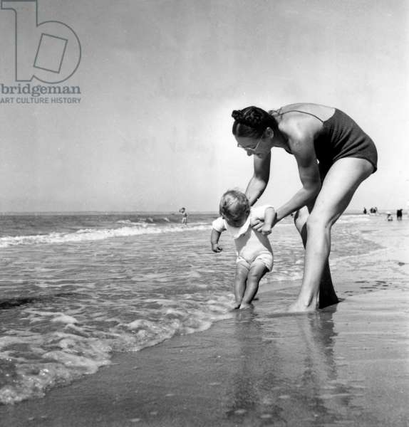 A Mom And Her Bebe On A Beach From Deauville July 1946 (b/w photo)