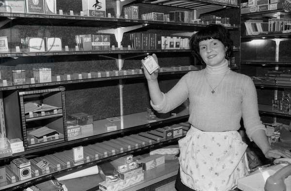 A French tobacconist in front of her almost empty shelves during the cigarettes deliverers strike in the Paris area, on May 12, 1975
