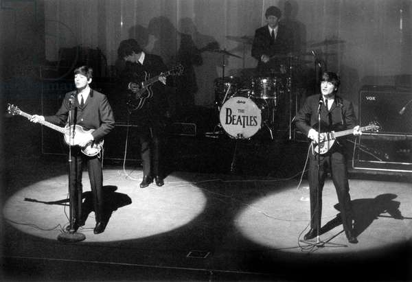 The Beatles Paul McCartney, George Harrison, Ringo Starr and John Lennon on January 17, 1964 at The Olympia in Paris (b/w photo)