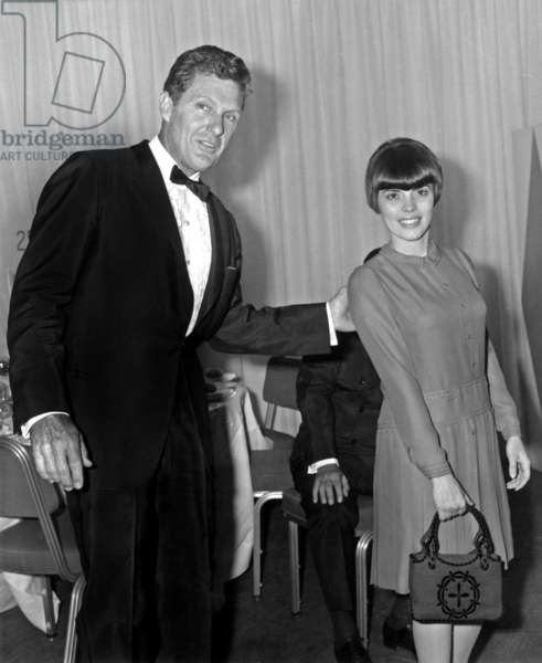 Robert Stack and Mireille Mathieu during Diner at Hilton Hotel in Paris May 25, 1966 (b/w photo)