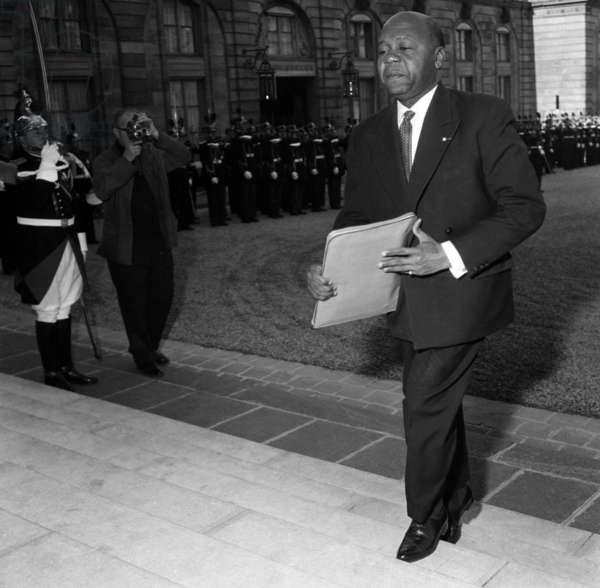 Leon M'Ba (Future President of Gabon) Arriving at Elysee in Paris To Attend Meeting of Franco-African Community March 2, 1959 (b/w photo)