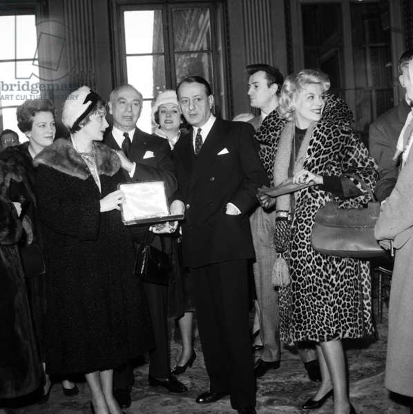 Andre Malraux Giving A Brooch Which Belonged To Sarah Bernhardt To Maurice Escande (Administrator of The Comedie Francaise) in Presence of Therese Marney, Gisele Casadesus, Lise Delamare, Marie Sabouret, February 16, 1960 (b/w photo)