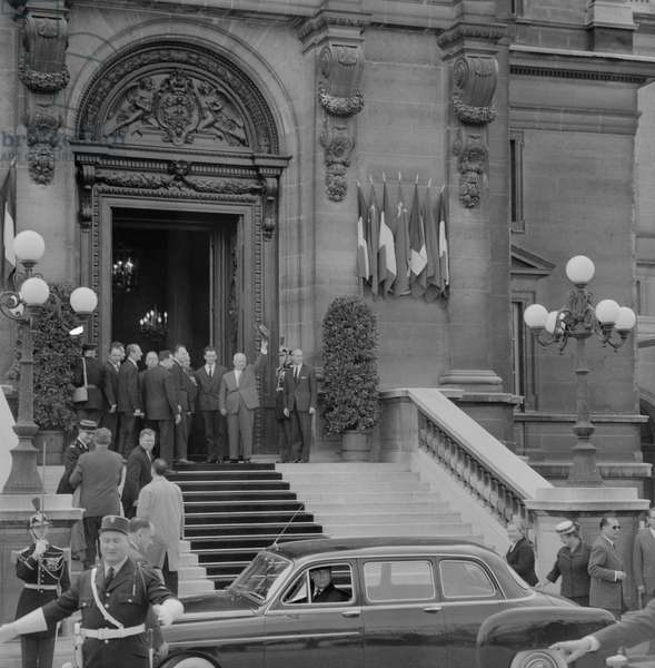 First Secretary of the Communist Party of the Soviet Union Nikita Khrushchev waving to the crowd from the steps of the Ministry of Foreign Affairs headquarters during his state visit in Paris on March 31, 1960