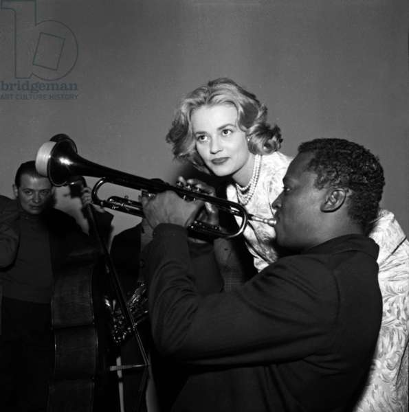 """Jeanne Moreau and Miles Davis during Recording of The Music of Film """"Elevator To The Gallows """" on December 5 1957 (b/w photo)"""