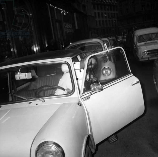 Singer Dalida, in her Austin Mini Car, Leaving Olympia in Paris After Rehearsal, January 14, 1974 (b/w photo)