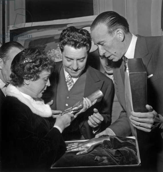 1St Anniversary of Wedding of Edith Piaf and Jacques Pills January 4, 1954 : They Are Looking at A Cast of The Hands of Piaf (b/w photo)