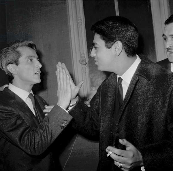 French singer Enrico Macias congratulating French singer Michel Aumont after his concert, on September 30, 1964