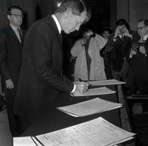 American Senator Robert (Bobby) Kennedy Signing Register at The Invalides in Paris January 31, 1967 (b/w photo)