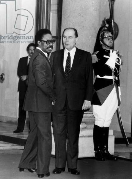 French President Francois Mitterrand and President of Gabon Omar Bongo in Paris, Elysee Palace, October 4, 1984 (b/w photo)