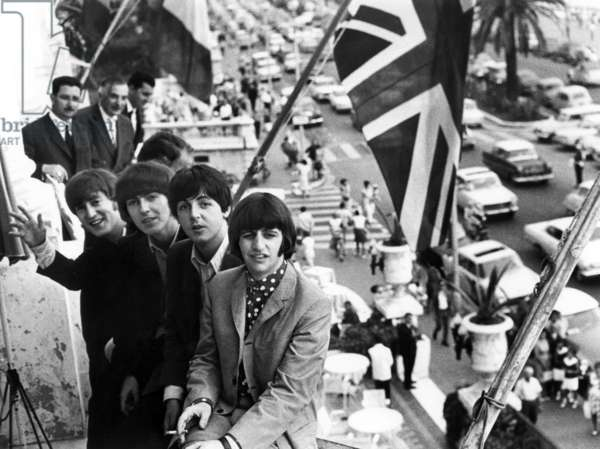 The Beatles (John Lennon, George Harrison, Paul McCartney and Ringo Starr) on the terrace of the Negresco Hotel, Nice, June 1965