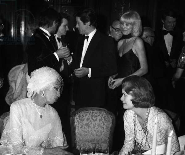 Grace Kelly, Princess of Monaco, Congratulating Josephine Baker at The Gala of The 50 Years of Music Hall of Josephine Baker on April 9, 1975. Behind : Alain Delon and Mireille Darc (b/w photo)