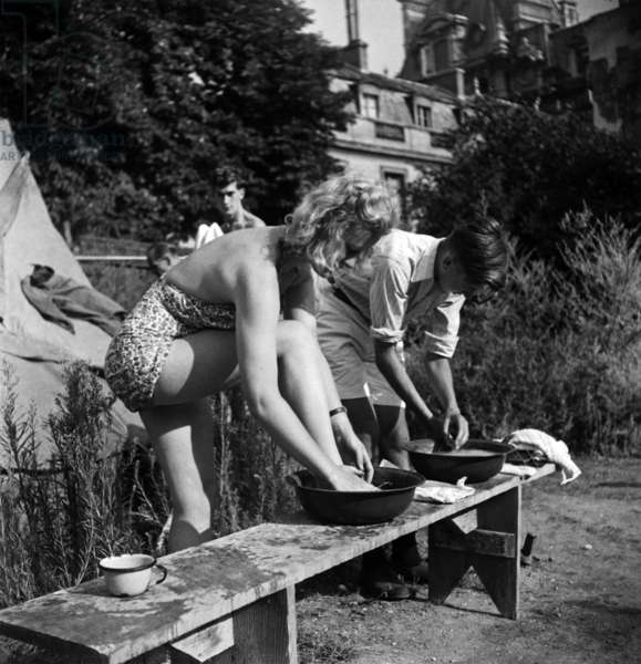 Camping in France, Jumy 1947 : Couple Washing With Small Bowls (b/w photo)