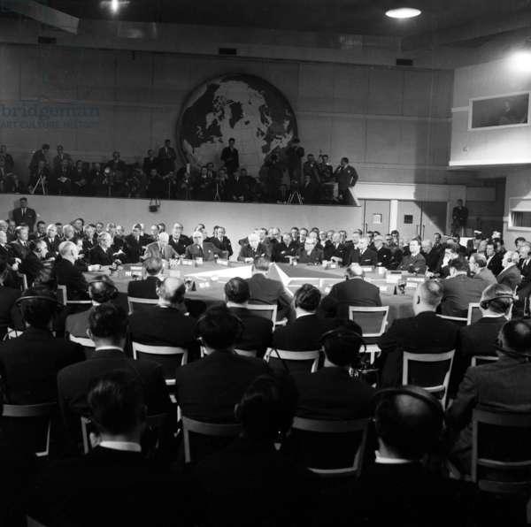 Nato Summit in Paris (Chaillot) on December 16, 1957 : Harold Macmillan, David Dwight Eisenhower (Speaking), Paul-Henri Spaak, Joseph Bech (Luxemburg), Achille Van Acker (Belgium), John Diefenbaker (Canada), Eric Ninn-Hansen (Denmark), Felix Gaillard (France), Conrad Adenaue (Germany), Constantine Karamanlis (Greece) (b/w photo)