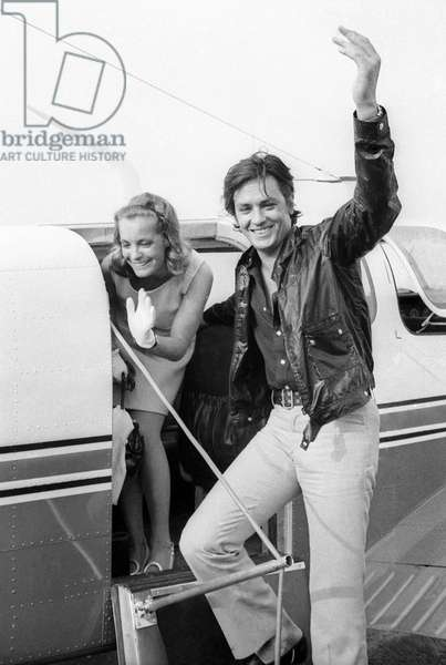 At Nice Airport, Alain Delon and Romy Schneider Taking A Plane To Go in Saint Tropez For Filming of Film Lapiscine, August 12, 1968 (b/w photo)