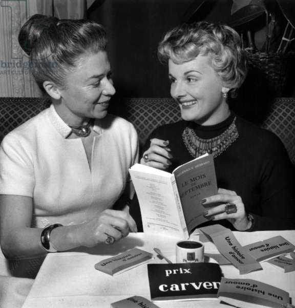 Carven Prize : Mrs Carven (R) and Winner Frederique Hebrard December 7, 1956 (b/w photo)