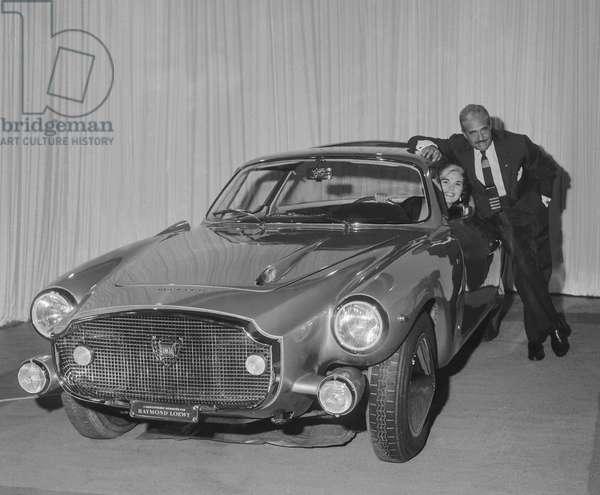 "Raymond Loewy showing the Lancia ""Loraymo"" car he drawn, Paris, October 5, 1960 (b/w photo)"