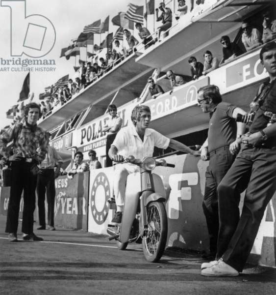 American actor Steve Mcqueen on Le Mans Circuit (France) Observing A Race To Prepare his Film (Le Mans) on May 13, 1969 (b/w photo)