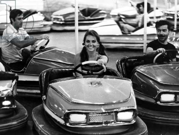 The American Actress Natalie Wood Playing in The Bumper Car of Luna Park, Near Saint Tropez, during The Holidays in The French Riviera  (b/w photo)