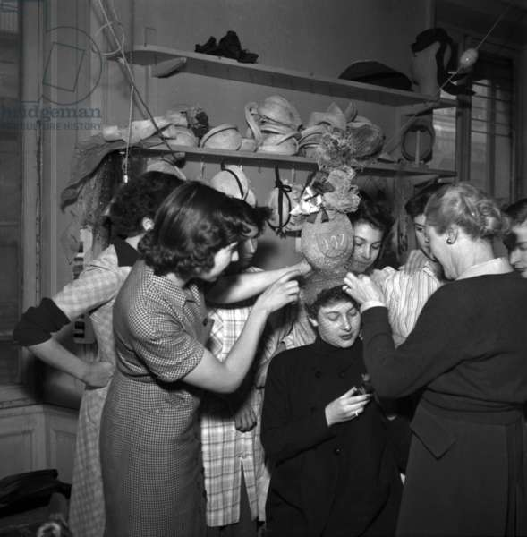 Young Woman in France in November 1952 on Saint Catherine Day : Holiday Made For Women Who Reach 25 Years of Age Without Marrying Which Symbolized Their Spinsterhood They Wore Unusual Hats To Show Their Status (b/w photo)