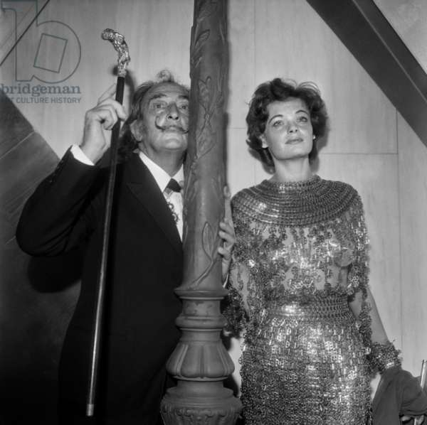 Private View of The Exhibition Presenting 3 Lithographs By Salvador Dali. here The Artist With A Woman 'The Street Lamp Lighter', Art-Contact Gallery, Paris, November 17, 1971 (b/w photo)