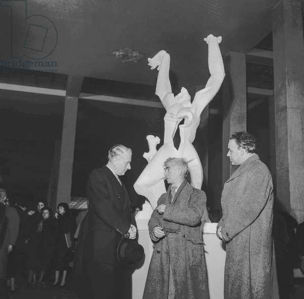 Sculptor Ossip Zadkine showing a scale model of his monument about the martyrdom of Rotterdam, Musee d'Art Moderne, Paris, December 6, 1951 (b/w photo)
