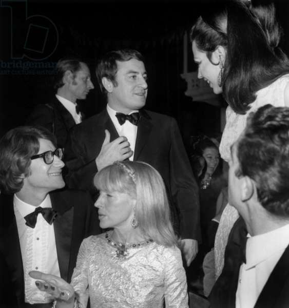 Yves Saint-Laurent, Mrs Weisweiller and Ira Furstenberg (Standing) at Gala of Lido in Paris December 21, 1966 (b/w photo)