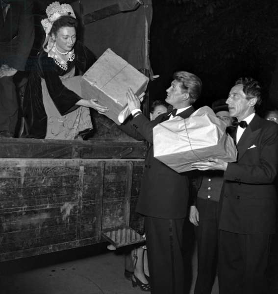 """Jean Marais and Jean Cocteau at Gala For Film """"La Chartreuse De Parme"""" at The Theatre Des Champs-Elysees, Paris, May 19, 1948. Each Celebrity Pay his Entrance With Presents For Orphans (b/w photo)"""