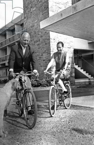 Curd Jurgens and his Wife Simone Bicheron Cycling during Their Holidays in Quiberon, France, July 13, 1968 (b/w photo)