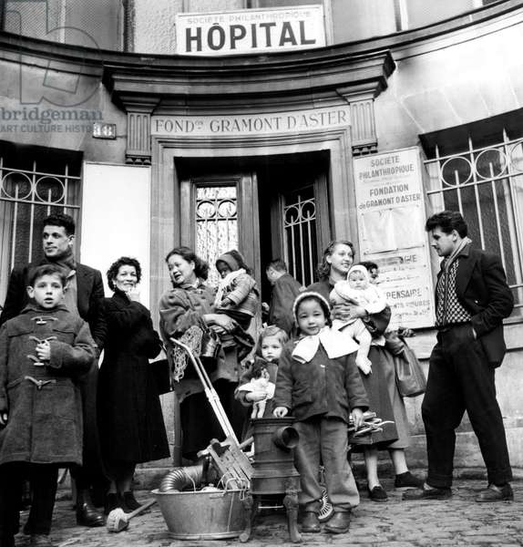 Poor Families Rehoused in Disused Hospital in Paris December 28, 1955 (b/w photo)