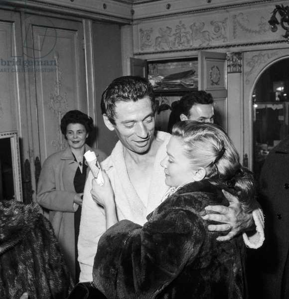 "Yves Montand congratulated by Daniele Delorme after last rehearsal of play ""The Crucible"" at the Theatre Sarah-Bernhardt in Paris on December 14, 1954 (b/w photo)"